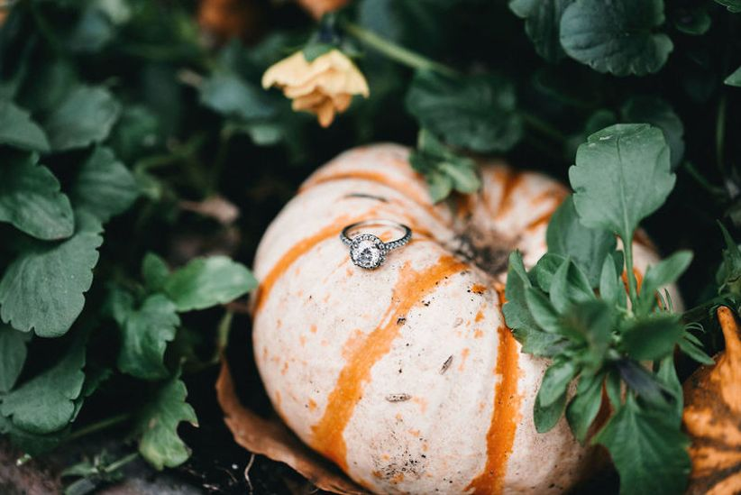 fall engagement ring idea with mini pumpkin