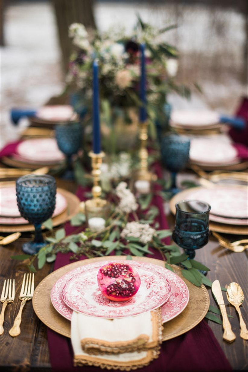 fall wedding place setting with fresh pomegranate
