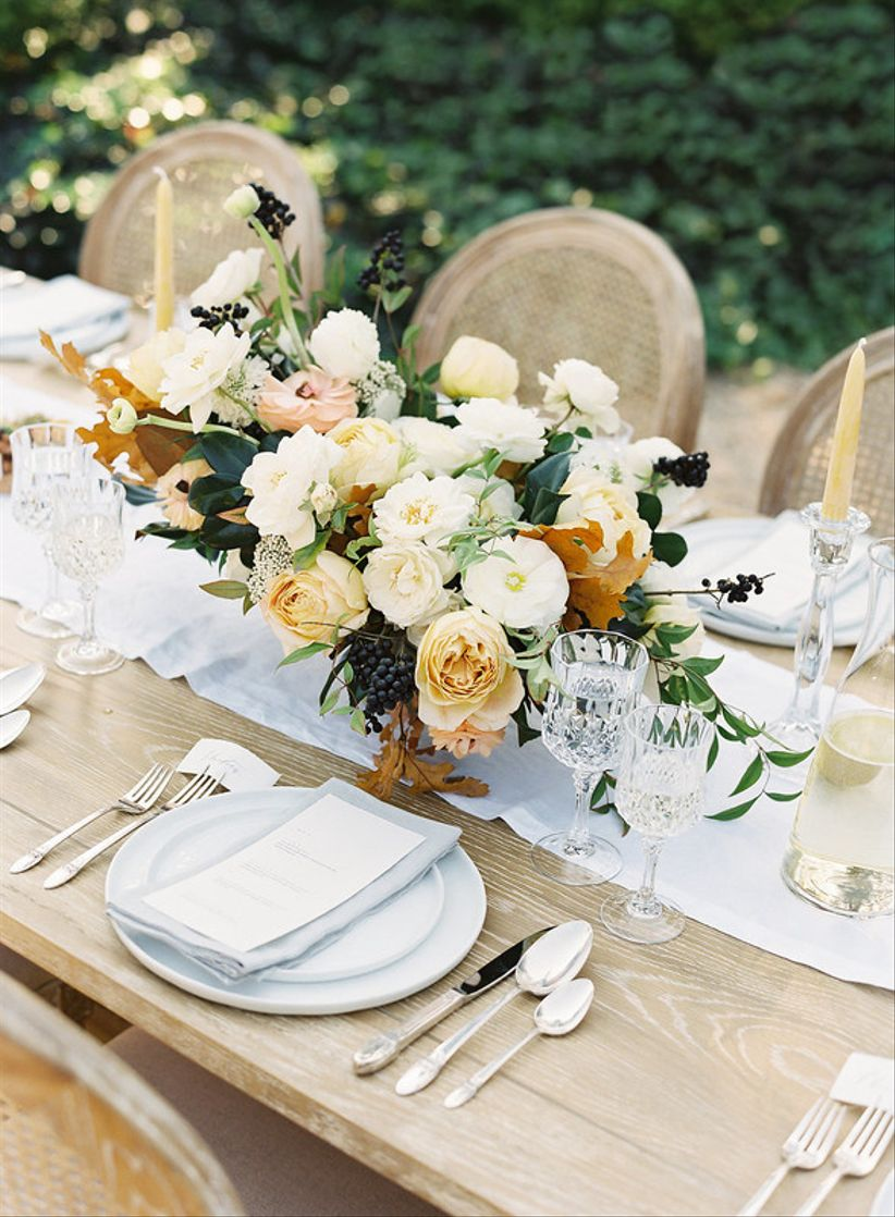 modern fall wedding tablescape with yellow rose centerpiece and pale blue table runner