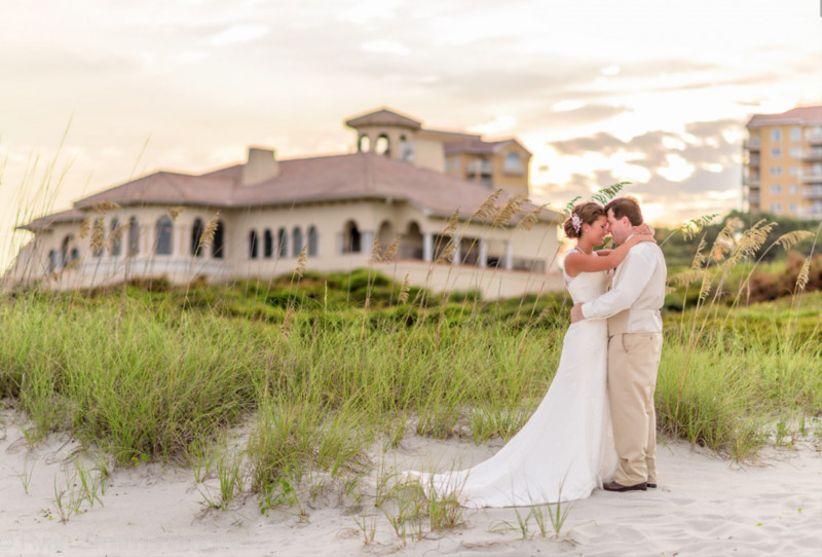 bride and groom wedding portraits on beach