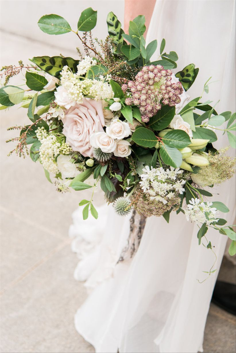 romantic wedding bouquet with blush flowers and greenery