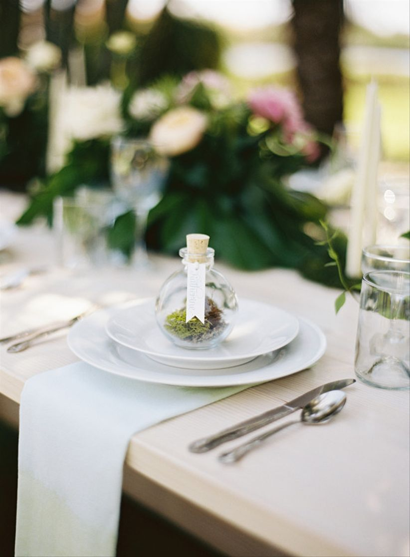 forest wedding place card idea - glass cork top bottle with moss
