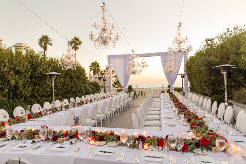 glam outdoor wedding reception with chandeliers