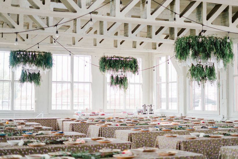 whimsical wedding reception with greenery chandeliers