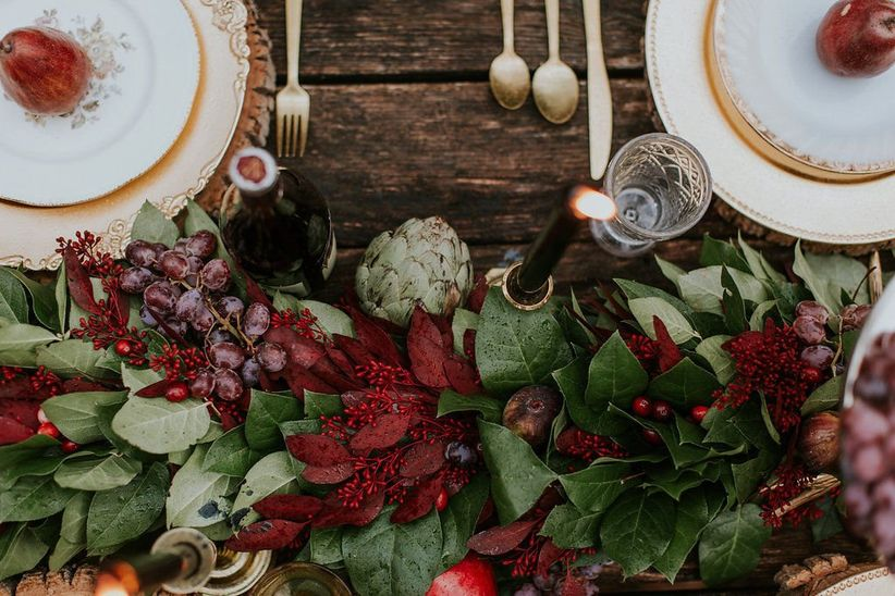 winter wedding decor with greenery and artichokes
