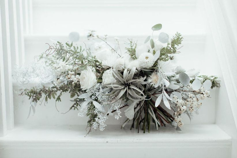 white wedding bouquet with ranunculus, eucalyptus and air plant