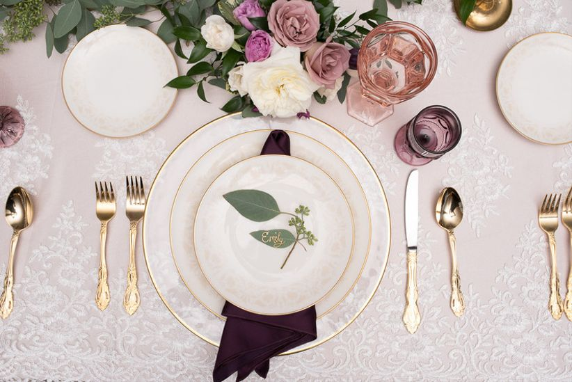 glam wedding tablescape with purple and gold decor