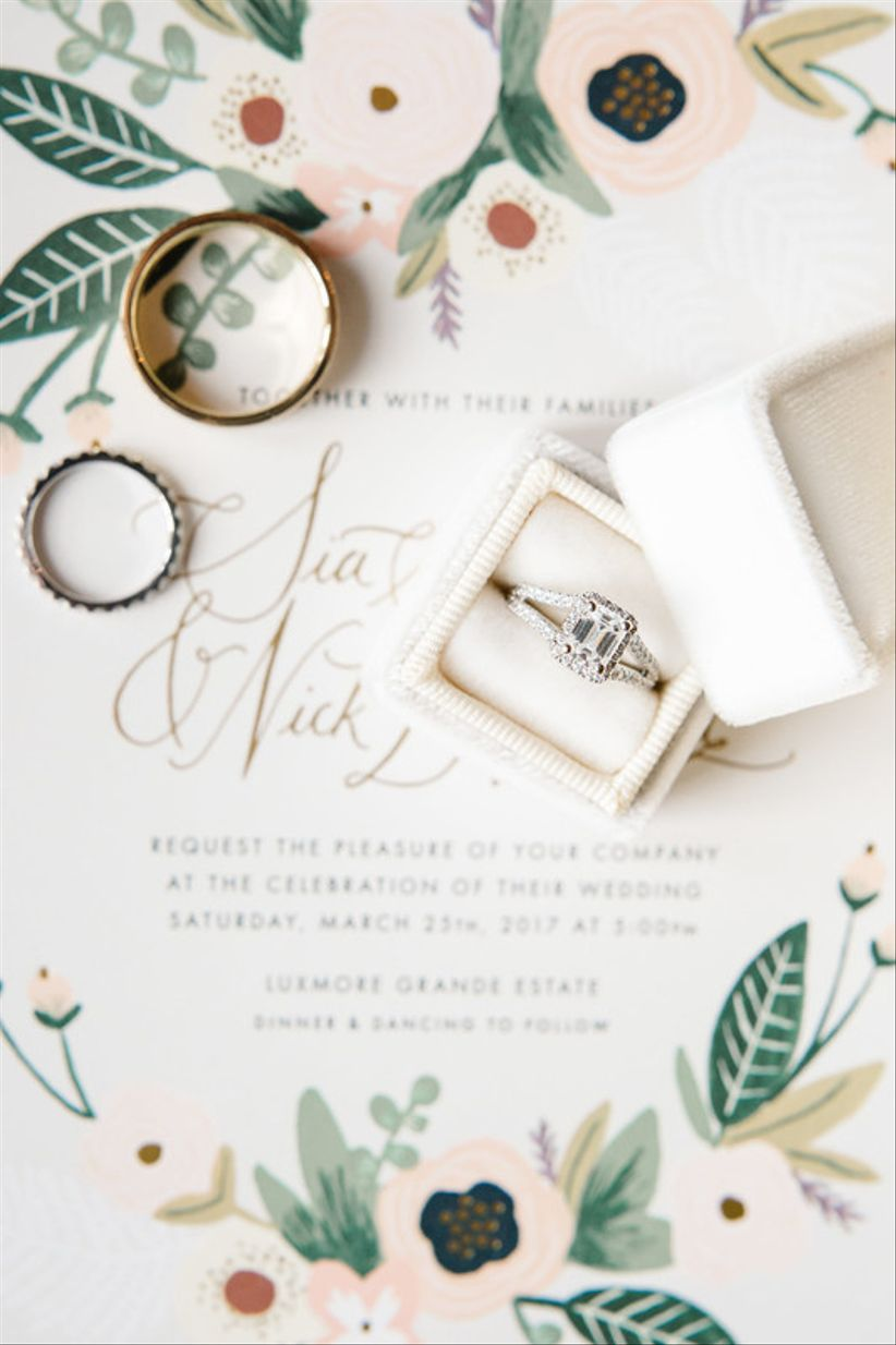 emerald cut engagement ring and romantic wedding invitations with blush and green flowers