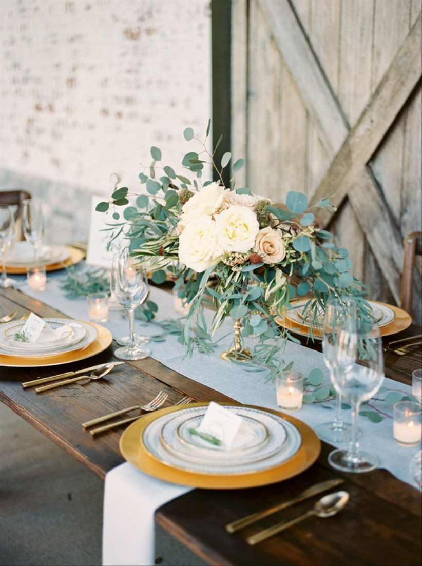 romantic winter wedding tablescape with light blue and gold decor