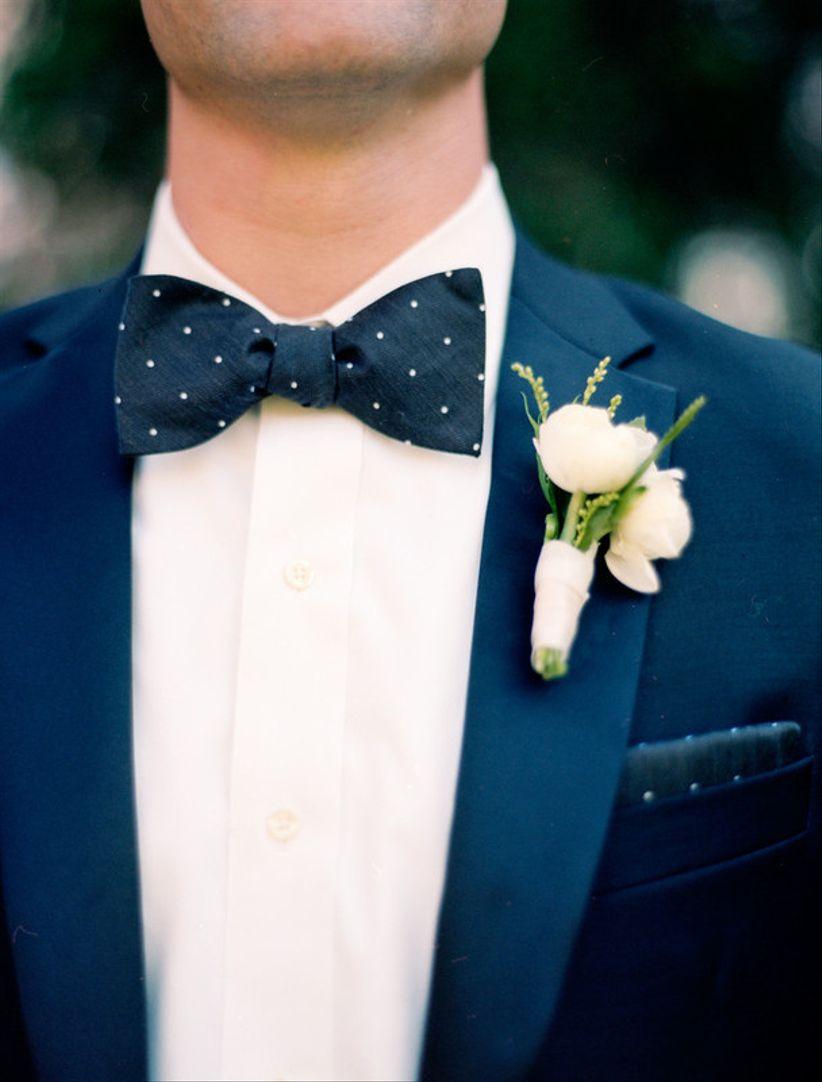 formal groom attire navy blue tuxedo with navy blue polka dot bow tie