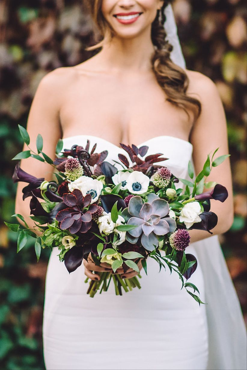 earthy wedding bouquet with succulents and greenery