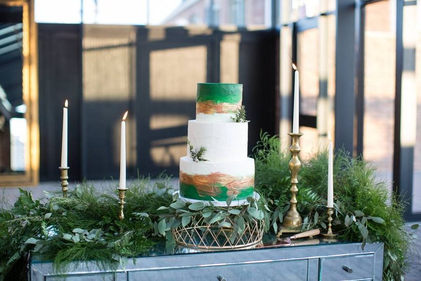 three-tier wedding cake decorated with abstract green and gold edible paint
