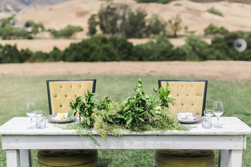 sweetheart wedding reception table with greenery centerpiece