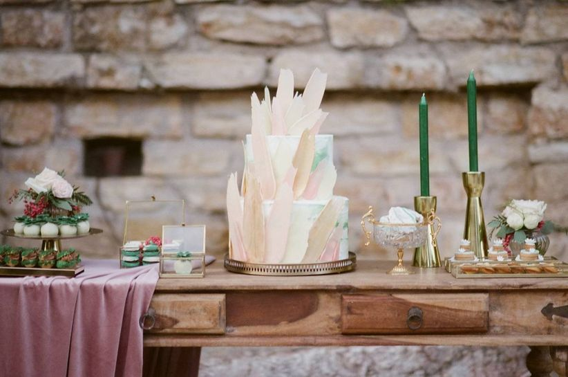 cake table with green tapers in gold candlesticks