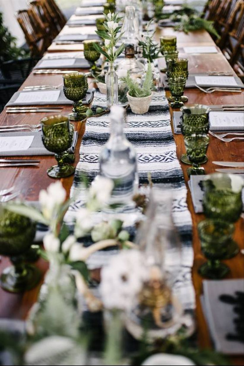 boho wedding reception tablescape with green glassware