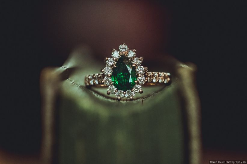pear-cut emerald engagement ring with halo setting