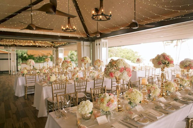 formal wedding reception tables with white linens and tall rose centerpieces