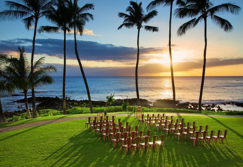 outdoor oceanfront wedding ceremony at sunset