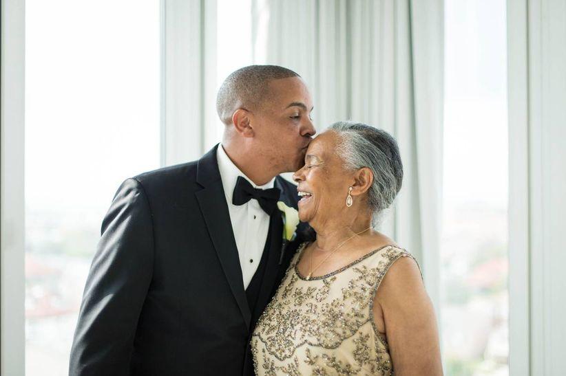 groom kissing mom