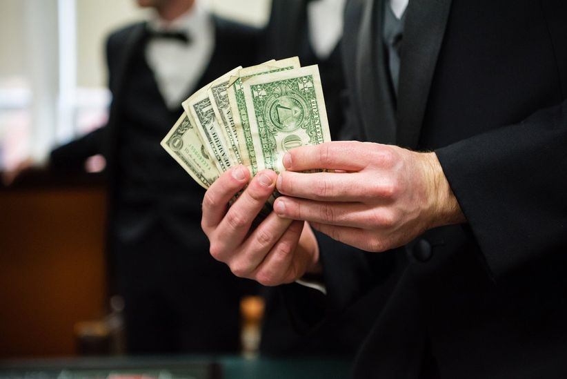 wedding guest holding money