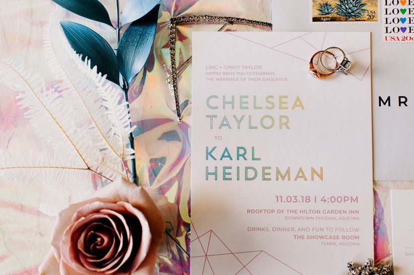wedding invitation with holographic words in winter wedding colors like pastel pink and metallic gold