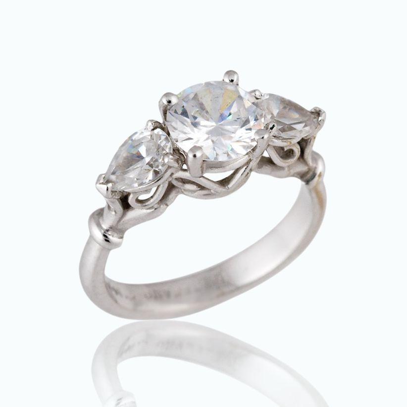 round stone and three stone setting engagement ring