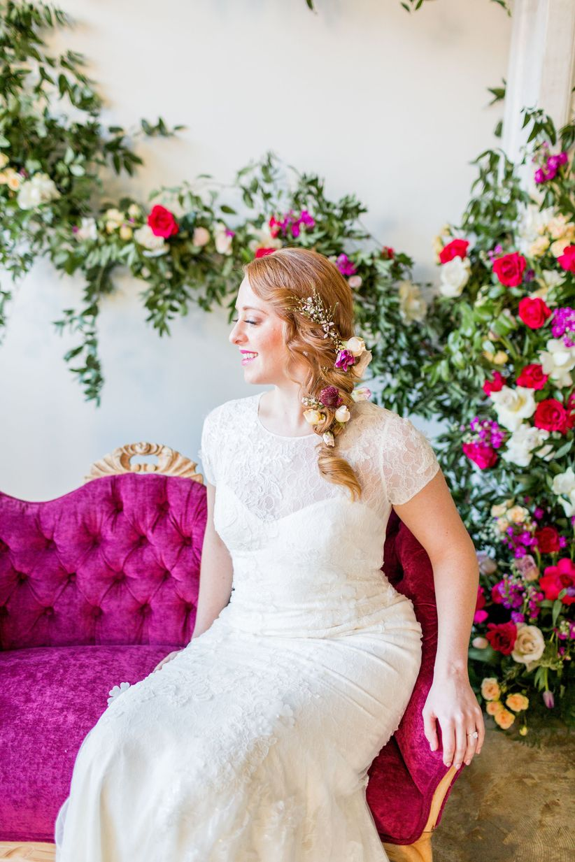 bride on magenta chair