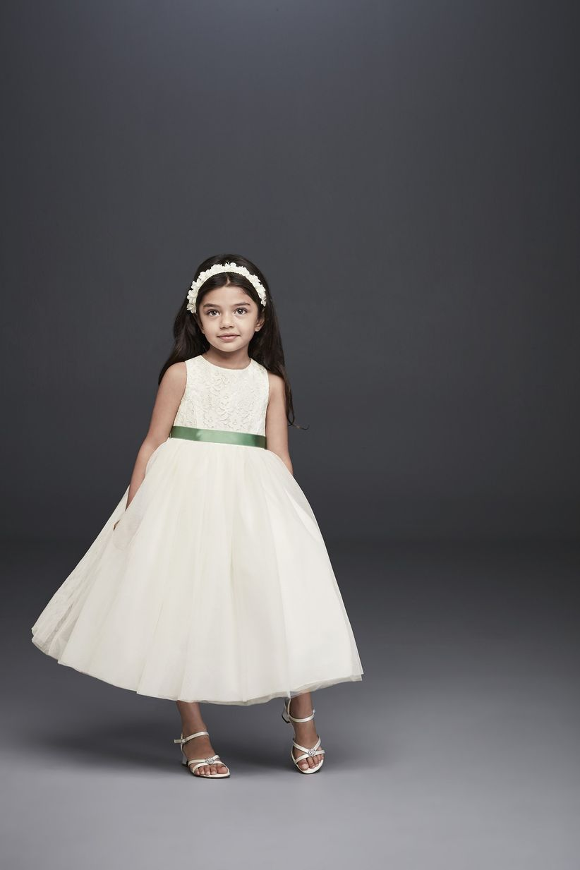 5498fb8a08f The shimmery metallic detailing on the bodice of this flower girl dress is  totally made for an upscale