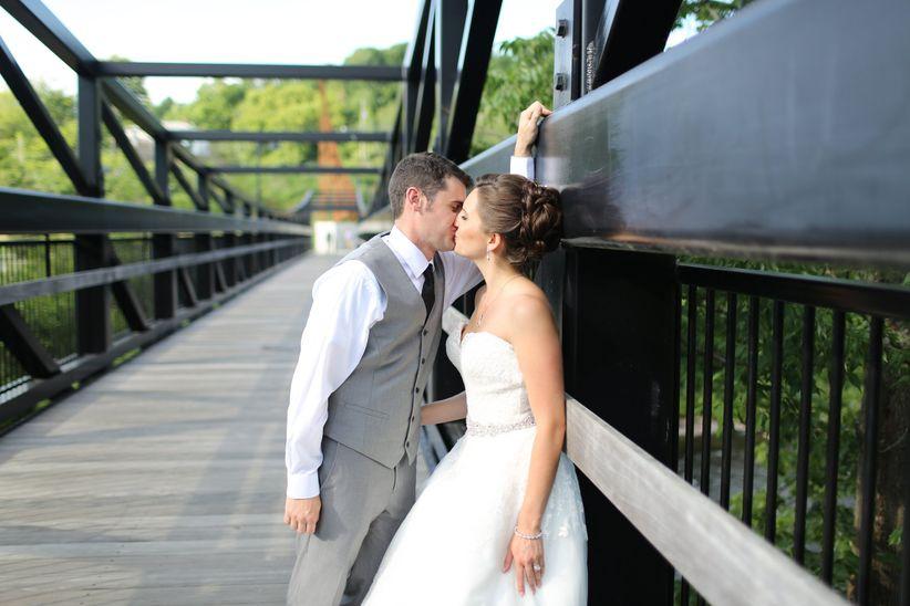 wedding couple kissing new hampshire bridge
