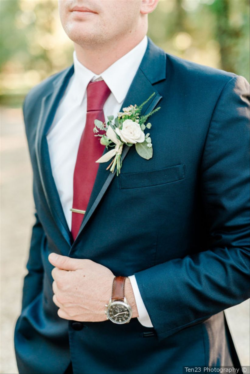 close-up of groom's suit and burgundy tie