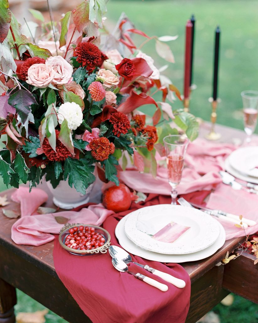 close-up of red and pink wedding table decor