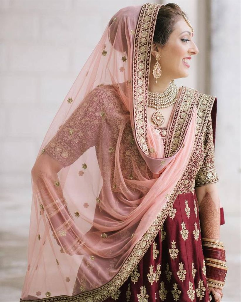 south asian bride with pink and red lehenga