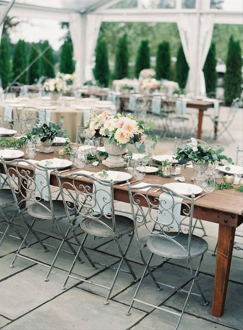 vintage wedding theme English garden-style reception table with folding metal chairs