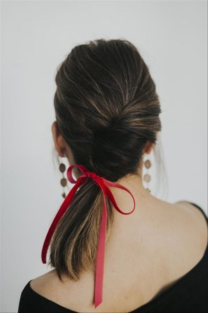 braid with red ribbon bow