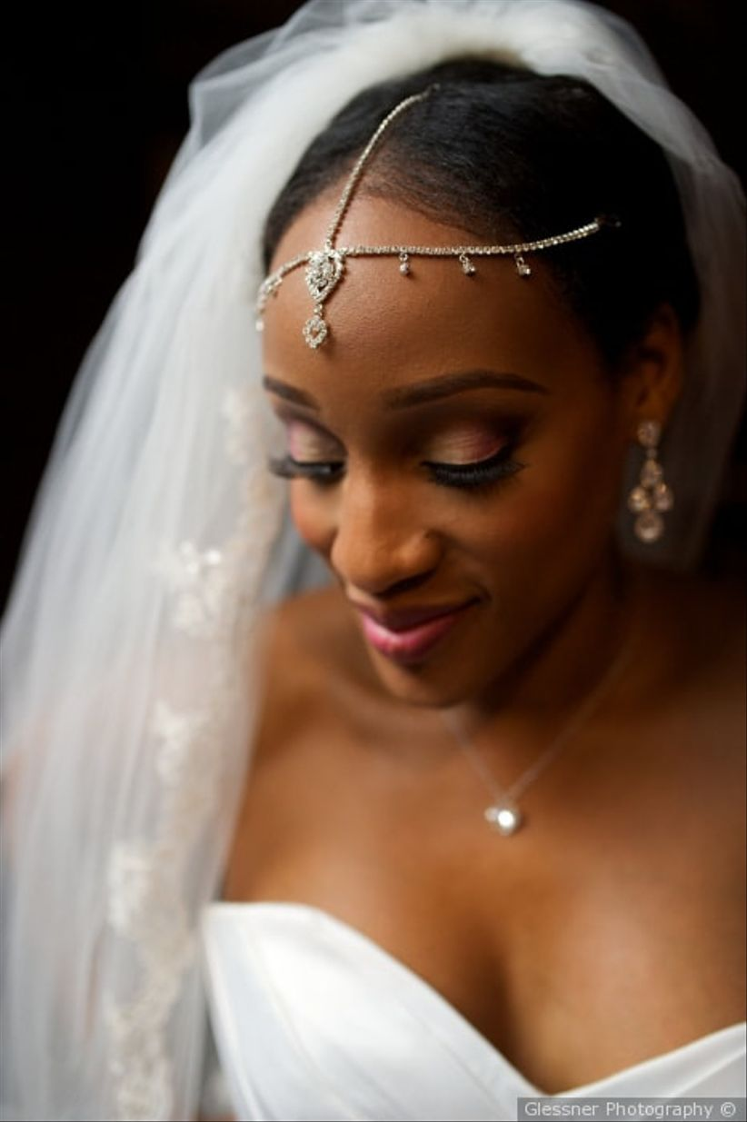 bride wearing forehead tiara