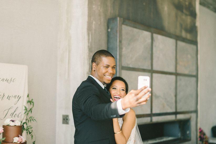 wedding couple taking selfie