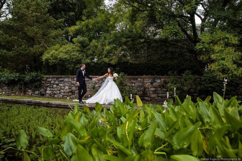couple walking garden wedding