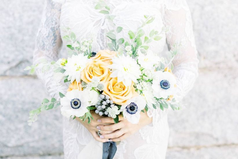 classic wedding bouquet with white anemones yellow roses