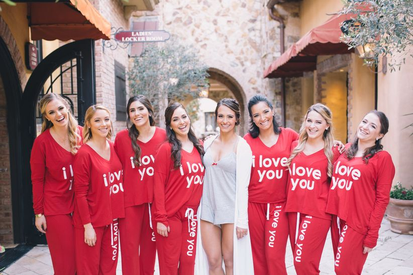 bridesmaids wearing matching red pajamas