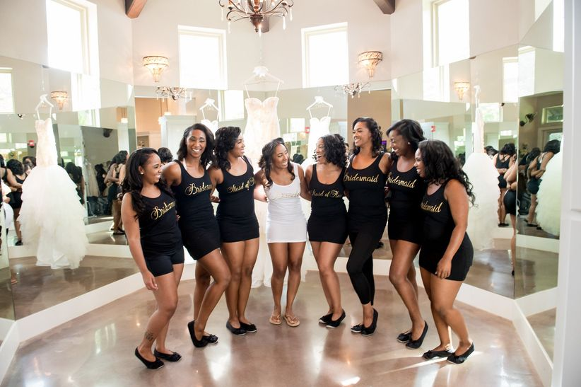 bride and bridesmaids wearing matching tank tops