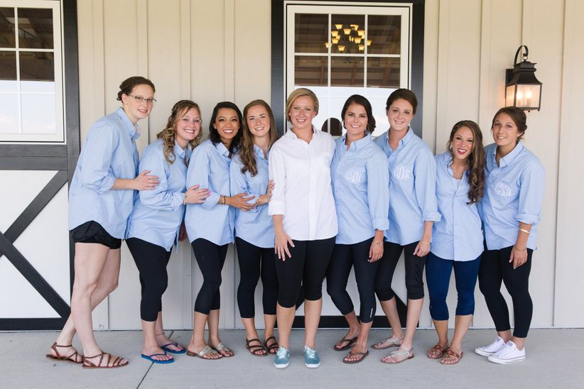 bride and bridesmaids wearing button down shirts
