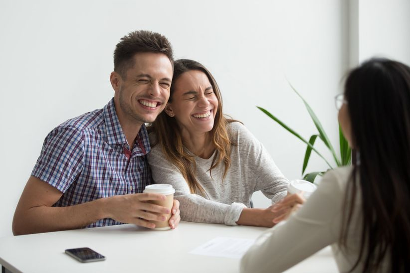 couple in a meeting laughing