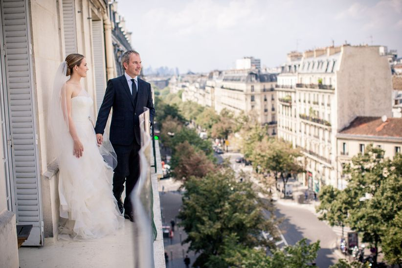 wedding couple standing on balcony in paris