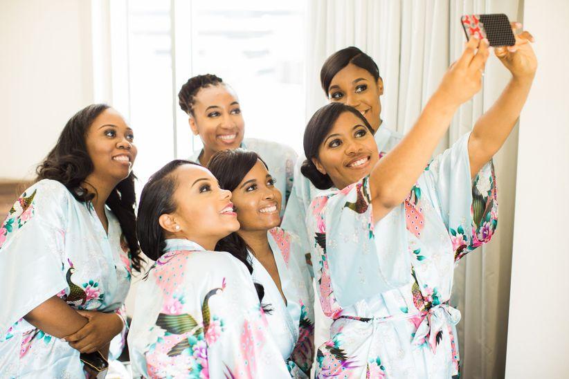 bridesmaids in matching robes taking selfie