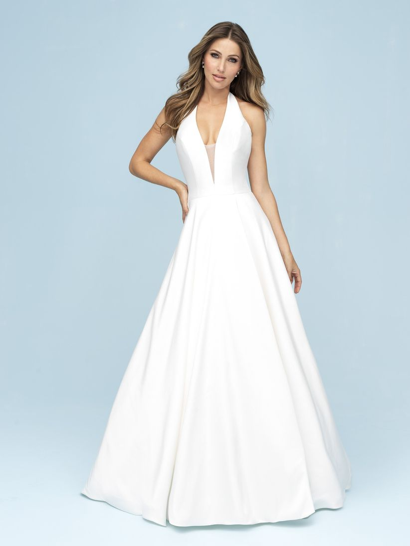 brunette bride wearing halter neck A-line dress with low illusion neckline