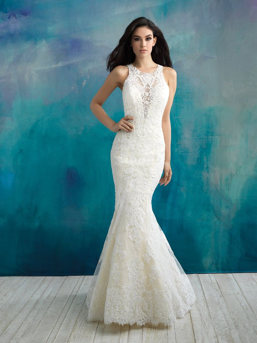 bride wearing sleeveless lace wedding dress with illusion v-neckline