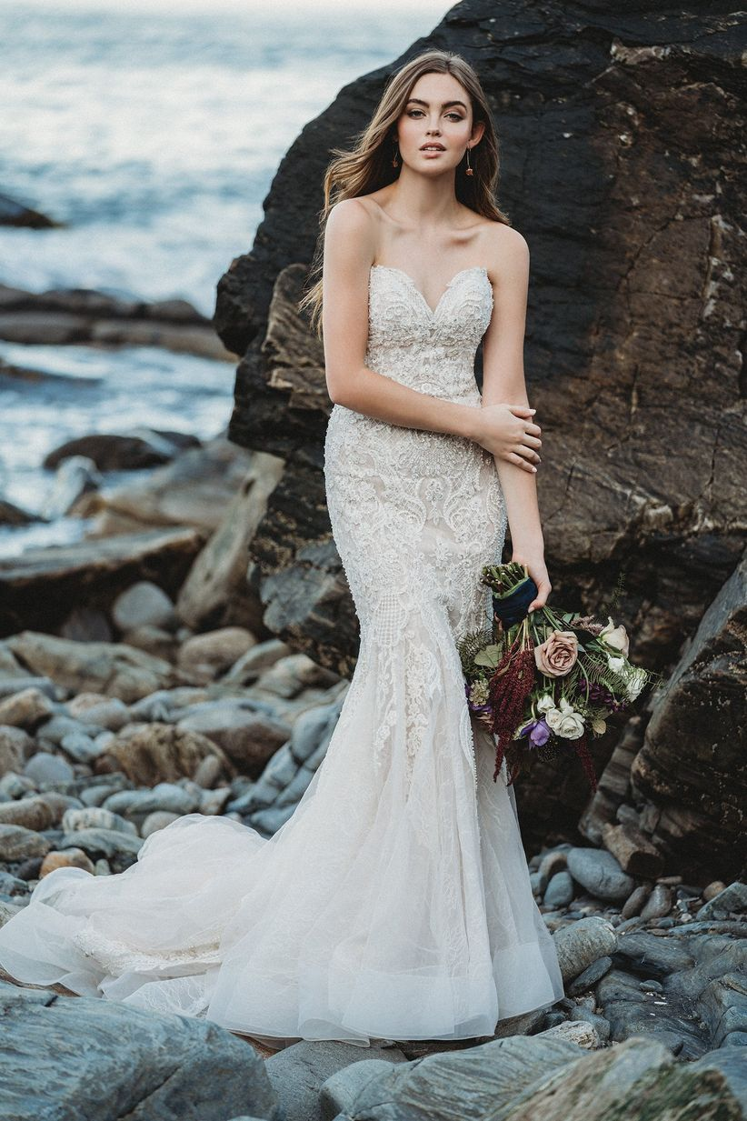 blonde bride wearing beaded wedding dress with sweetheart neckline