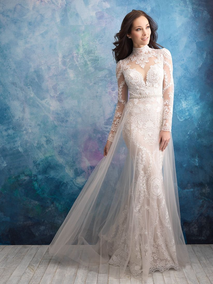 brunette bride wears lace wedding dress with long sheer sleeves and high neckline