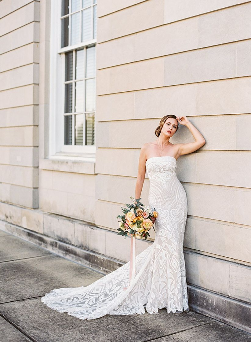 bride wearing strapless fit-and-flare wedding dress with geometric lace pattern
