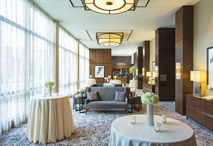 modern hotel lounge with wedding reception tables